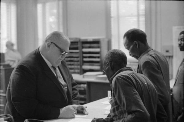 Circuit Clerk Theron Lynd with voter registration applicants in Hattiesburg, Mississippi, January 22, 1964, Moncrief Photograph Collection, MDAH